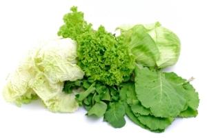 Fresh vegetables leaves on white background .